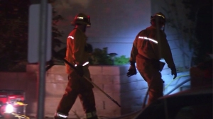 A woman died and her husband hospitalized after a fire broke out at a Castaic home on Dec. 28, 2014. (Credit: KTLA)