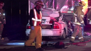 A father and two children were killed in a crash early Dec. 8, 2014, in a brake-check lane off the 5 Freeway north of Castaic. (Credit: OnScene.TV)