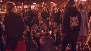 Protesters sat outside an Iggy Azalea concert at USC on Dec. 4, 2014. (Credit: KTLA)