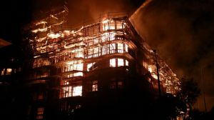 A fire burned at a downtown L.A. apartment building on Monday, Dec. 8, 2014. (Credit: KTLA)