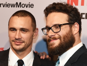 Actors James Franco (L) and Seth Rogen arrive for the premiere of the film 'The Interview' at The Theatre at Ace Hotel in Los Angeles, California on December 11, 2014. (Credit: AFP/Getty Images)