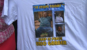 Eric Garner's photo is seen on a T-shirt worn in a protest march in New York. (Credit: WPIX via CNN)