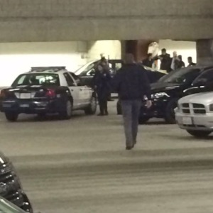 Police responded to a Hollywood & Highland parking garage after an officer shot a woman in the leg Friday, Dec. 26, 2014. (Credit: Mark Mester/KTLA)