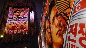 Movie posters for the premiere of the film 'The Interview' at The Theatre at Ace Hotel in Los Angeles, California on December 11, 2014. (Credit: AFP/Getty Images)