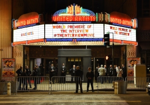 Security is seen outside The Theatre at Ace Hotel before the premiere of the film 'The Interview' in Los Angeles, California on December 11, 2014. (Credit: AFP/Getty Images)