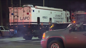 An LAPD mobile command post was set up after two officers were fired upon in South L.A. on Dec. 28, 2014. (Credit: KTLA)