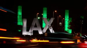 The 100-foot LAX Gateway pylons at Los Angeles International Airport are lit green on March 23, 2013. (Credit: Frederic J. Brown/AFP/Getty Images)