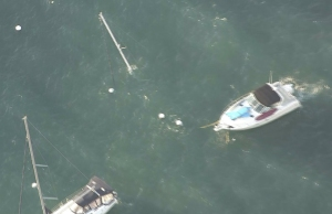 One boat appeared to have sunk and only its mast was sticking up above the water in Avalon Harbor on Dec. 31, 2014. (Credit: KTLA)