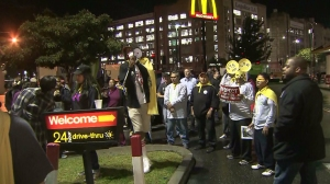 Striking workers, demanding a $15 an hour wage, are seen outside a McDonald's restaurant in Los Angeles on Thursday, Dec. 4, 2014.  (Credit: KTLA)