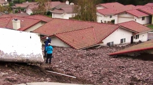 Several homes in Camarillo Springs had mud and debris up to their rooftops after a downpour Friday morning. (Credit: KTLA)