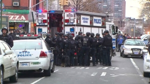Two NYPD officers shot in the head and killed on Dec. 20, 2014. (Credit: PIX11)
