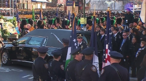 Police officers from around the nation gathered Dec. 27, 2014, for NYPD Officer Rafael Ramos' funeral. (Credit: CNN)