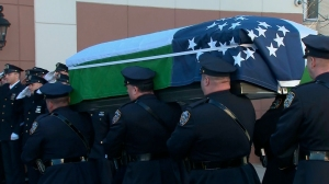 The casket of New York police officer Rafael Ramos was carried by an honor guard into the Christ Tabernacle Church in Glendale, New York on Friday, Dec. 26, 2014. (Credit: CNN)