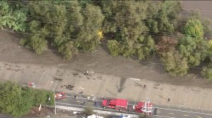 Two people were rescued from the raging Los Angeles River on Dec. 12, 2014. (Credit: KTLA)
