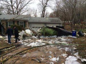 A twin-engine jet plane came down near houses on Drop Forge Lane in Gaithersburg, Maryland, on Dec. 8, 2014. (Credit: Pete Piringer/Montgomery County Fire)