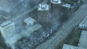 Sky5 aerial footage showed a badly damaged seven-story apartment complex in downtown L.A. that caught fire Dec. 8, 2014. (Credit: KTLA)