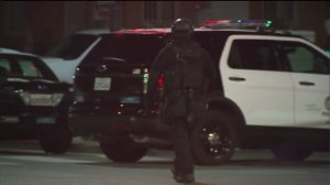 A massive manhunt was underway in South LA in the early morning hours of Dec. 29, 2014, after two officers were fired upon the previous night. (Credit: KTLA)