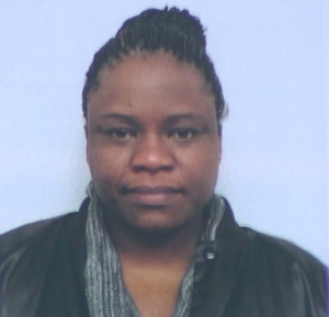 Tiffani Lowden, 38, a resident of Whittier, turned herself in Dec. 22, 2014. She is shown in an image displayed at a police news conference the following day. (Credit: KTLA)