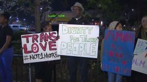 Activists held signs at a vigil for Deshawnda Sanchez on Dec. 5, 2014. (Credit: KTLA)
