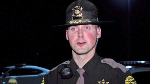 Trooper Andrew Pollard of the Utah Highway Patrol helped escort an 87-year-old woman to a hospital so that she could see her gravely ill son. (Credit: KUTV/via CNN)