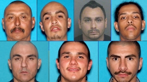 Photos released by the FBI Dec. 10, 2014, show seven men wanted in connection with federal indictments related to criminal gang activity at the Ramona Gardens housing complex in Boyle Heights. Top row, left to right: Jose Lizarraga, Michael Mercado, Jerry Sala, David Smith. Bottom row, left to right: Javier Gutierrez, Luis Ortiz, Raymond Montes.