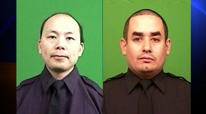 New York Police Department Officers Wenjian Liu, left, and Rafael Ramos were killed in an ambush-style killing in Brooklyn on Saturday, Dec. 20, 2014, Commissioner William Bratton said. (Credit: NYPD)