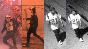 Authorities provided these video still images of two individuals who were described as a witnesses to a Dec. 8, 2014, fire in downtown Los Angeles.
