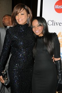 Singer Whitney Houston and her daughter, Bobbi Kristina Brown, arrive at the 2011 Pre-Grammy Gala and Salute To Industry Icons Honoring David Geffen at the Beverly Hilton Hotel on Feb. 12, 2011, in Beverly Hills. (Credit: Jason Merritt/Getty Images)