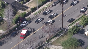 At least seven patrol cars were on scene where an LAPD officer was struck by a vehicle on Jan. 15, 2015. (Credit: KTLA)