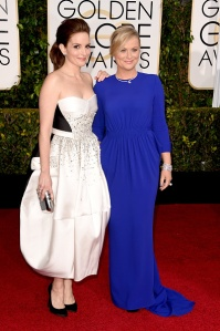 Hosts Tina Fey, left, and Amy Poehler attend the 72nd Annual Golden Globe Awards at The Beverly Hilton Hotel on Sunday, Jan. 11, 2015, in Beverly Hills. (Credit: Jeff Vespa/WireImage)