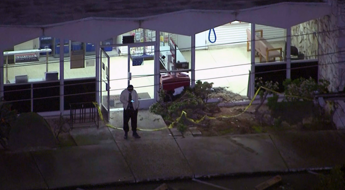 Police were at a Torrance post office where a motorist slammed into the building on Jan. 30, 2015. (Credit: KTLA)