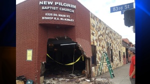 A hole is seen where the front door of the New Pilgrim Baptist Church once stood. (Credit: KTLA)