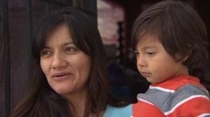 Maribel Hernandez holds her son Dylan, who was wounded by gunfire, on Jan. 26. 2015. (Credit: KTLA)