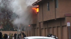 Intense flames shoot through windows and the roof of a San Juan Capistrano apartment building on Jan. 20, 2015.