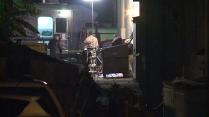 San Diego County investigators were combing for clues after the body of an infant was found in a dumpster at a strip mall on Jan. 5, 2015. (Credit: KSWB)