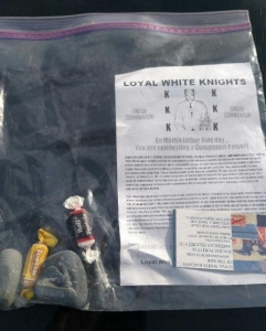The Santa Ana Police Department provided this photo of a Ziploc bag filled with candy, two rocks, anti-Martin Luther King Jr. sentiments and a KKK business card on Jan. 19, 2015. It was one of about 40 found in front of Santa Ana homes on Martin Luther King Jr. Day.
