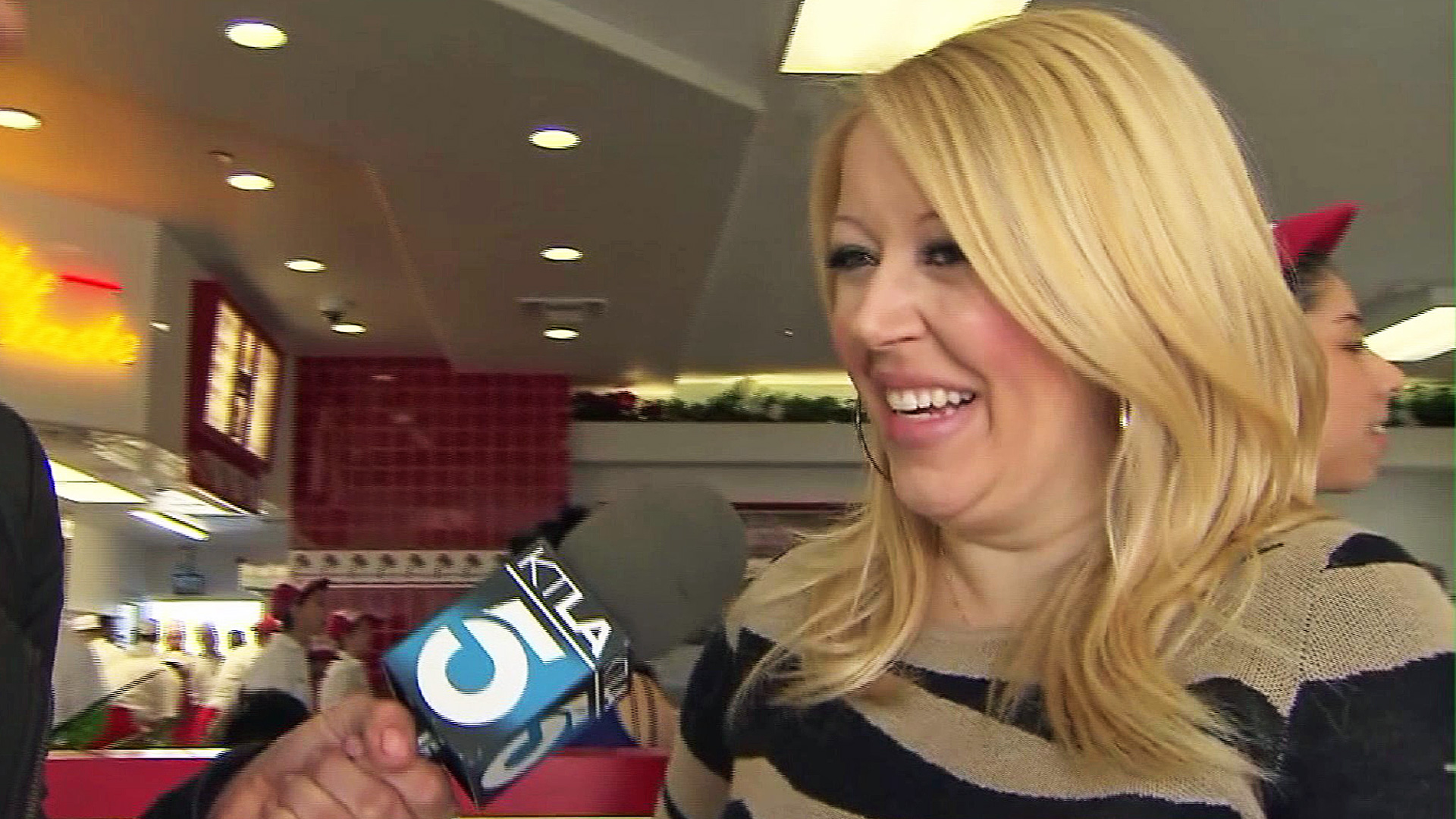 In-N-Out Burger owner Lynsi Snyder laughs after being asked about adding chicken to the menu. (Credit: KTLA)