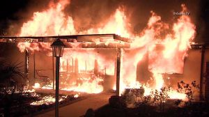 Flames tore through a home in North Hollywood on Jan. 6, 2015. (Credit: OnScene.TV)