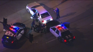 Five people, including the driver were taken into custody after a police pursuit on Jan. 14, 2015. (Credit: KTLA)