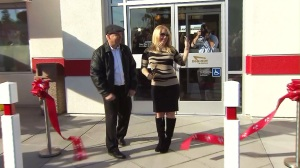 In-N-Out Burger owner Lynsi Snyder cuts the ribbon at the opening of a new restaurant in Anaheim on Wednesday, Jan. 7, 2015.