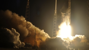 Space X's Falcon 9 rocket launches on Jan. 10, 2015, as it heads to space from pad 40 at Cape Canaveral, Florida, carrying the Dragon CRS5 spacecraft on a resupply mission to the International Space Station (ISS). The Dragon cargo vessel should arrive at the space station on Jan. 12, NASA said. The cargo ship is carrying more than 5,000 pounds (2,268 kilograms) of supplies to the astronauts living in orbit. Credit: BRUCE WEAVER/AFP/Getty Images)