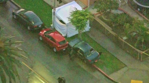The car appeared to have its rear window shattered at the scene of the LAPD investigation on Jan. 21, 2015. (Credit: KTLA)