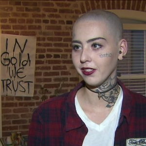 """""""It's art. It will annoy people or make them happy or make them smile. Either way, that's what art's supposed to do,""""  Illma Gore says of her latest goal of tattooing other peoples names and ideas on her entire body. (Credit: KTLA)"""