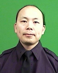 The New York Police Department provided this photo of Officer Wenjian Liu, who was killed in an ambush-style killing in Brooklyn on Saturday, Dec. 20, 2014.