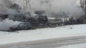 Vehicles were left burned after a pileup on snowy Interstate 94 near Battle Creek, Michigan, on Jan. 9, 2015. (Credit: WXMI)