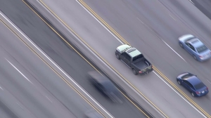 LAPD was in pursuit of a pickup truck in the San Fernando Valley on Feb. 23, 2015. (Credit: KTLA)