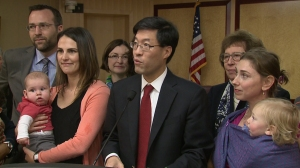 State Sen. Dr. Richard Pan stands with supporters as he introduces a vaccine-related bill in Sacramento on Feb. 4, 2015. (Credit: KTXL)