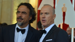 Nominee for Best Actor Michael Keaton, right, and nominee for Best Director Alejandro G. Inarritu arrive on the red carpet for the 87th Oscars on Feb. 22, 2015, in Hollywood. (Credit: Valerie Macon/AFP/Getty Images)