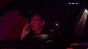 Pierce Brosnan was seen talking on his phone after a fire broke out at his Malibu home on Feb. 11, 2015. (Credit: Loudlabs)