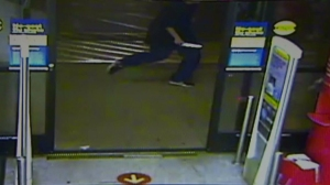 A still from a surveillance video released by Covina police shows a man armed with a knife chasing after a stabbing victim on Jan. 31, 2015.